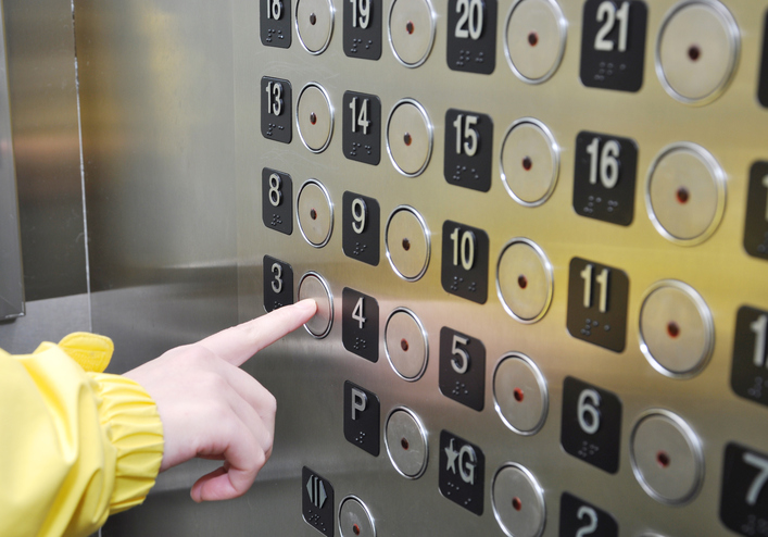 Pushing an elevator button