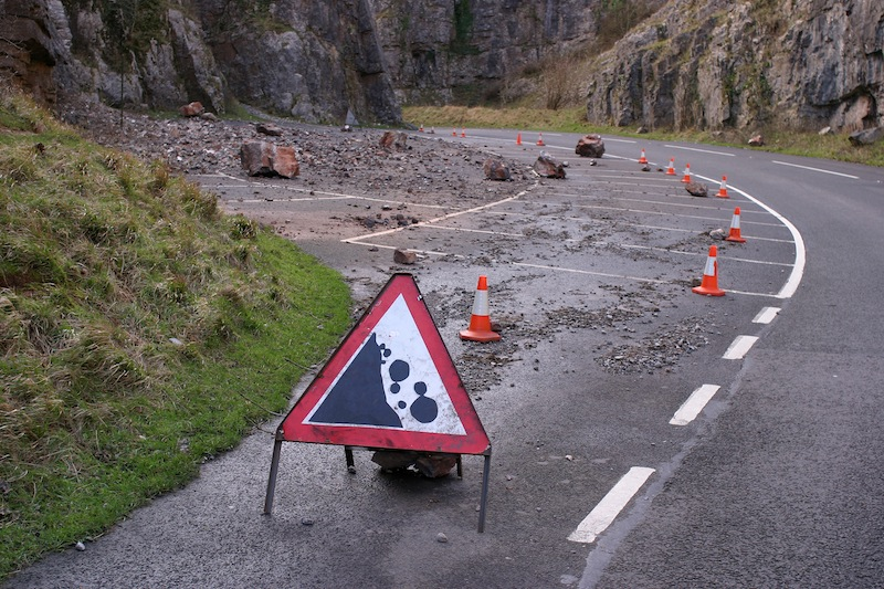 Rock fall into highway