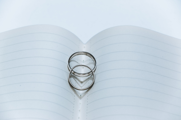 Heart shadow of Wedding Ring on center notebook