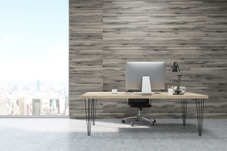 CEO working desk in office with wooden panels