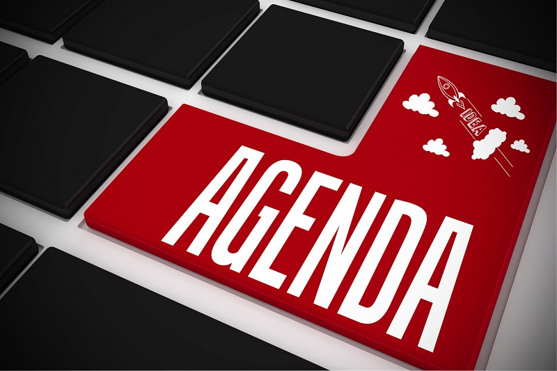 Agenda on black keyboard with red key