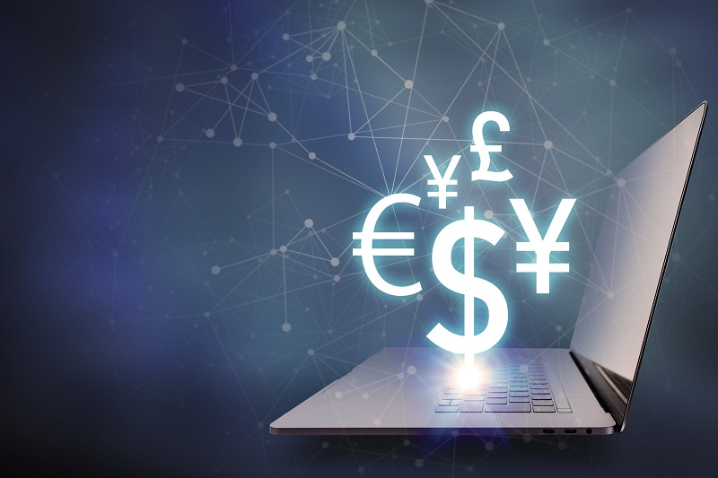 key currency symbols floating on laptop PC, financial technology concept