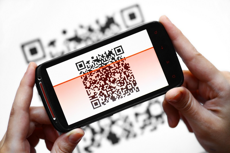 QR code reader demonstrated on hand-held smart phone